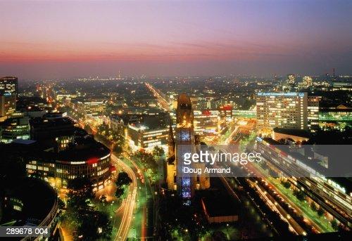 Germany,Berlin,Kaiser Wilhelm Memorial Church and Ku'damm at dusk : Foto de stock