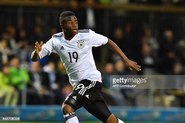 Germany's 12yearold Youssoufa Moukoko runs during the friendly U16 football match between Austria and Germany in Hippach Austria on September 11 2017...