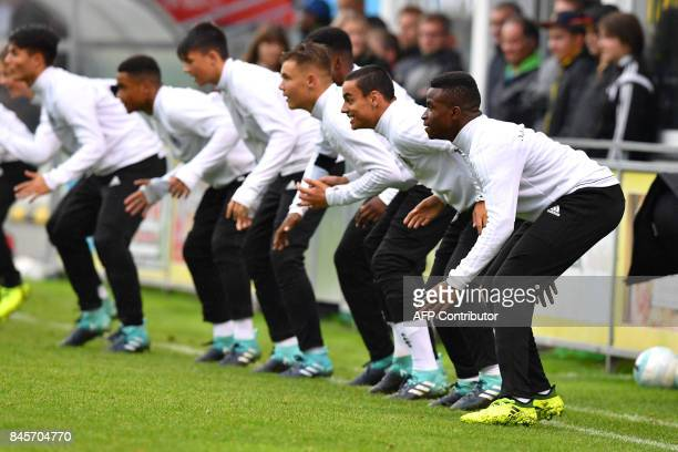 Germany's 12yearold Youssoufa Moukoko warms up during the friendly U16 football match between Austria and Germany in Hippach Austria on September 11...