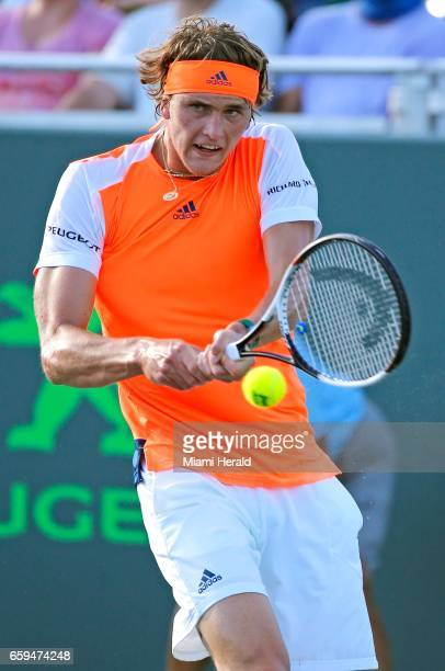 Germany's Alexander Zverev hits a return to Switzerland's Stan Wawrinka in the fourth round of the Miami Open at Crandon Park Tennis Center in Key...
