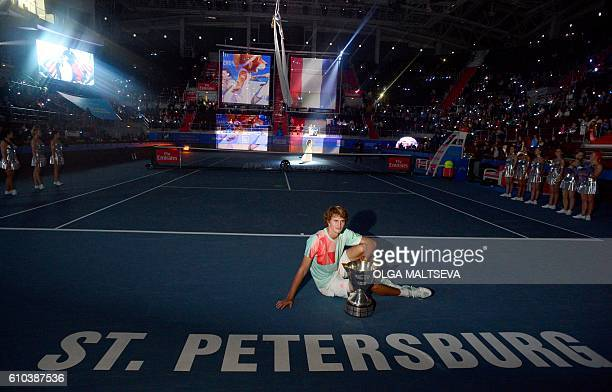 Germanys Alexander Zverev poses with his trophy after winning the St Petersburg ATP Open final tennis match against Switzerlands Stanislas Wawrinka...