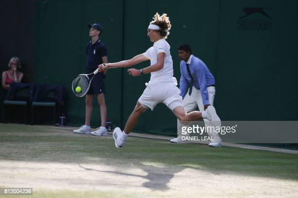 TOPSHOT Germany's Alexander Zverev returns against Canada's Milos Raonic during their men's singles fourth round match on the seventh day of the 2017...