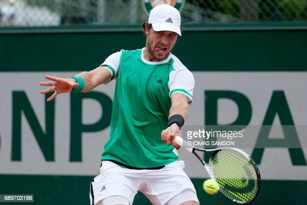 Germany's Alexander Zverev returns the ball to Italy's Stefano Napolitano during their tennis match at the Roland Garros 2017 French Open on May 29...