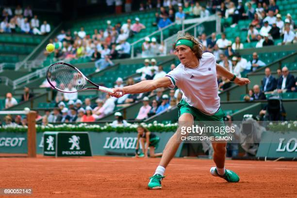 Germany's Alexander Zverev returns the ball to Spain's Fernando Verdasco during their tennis match at the Roland Garros 2017 French Open on May 30...