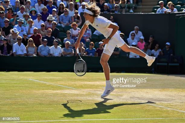 Germany's Alexander Zverev serves to Austria's Sebastian Ofner during their men's singles third round match on the sixth day of the 2017 Wimbledon...