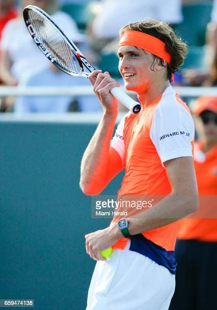 Germany's Alexander Zverev smiles before serving to Switzerland's Stan Wawrinka in the fourth round of the Miami Open at Crandon Park Tennis Center...