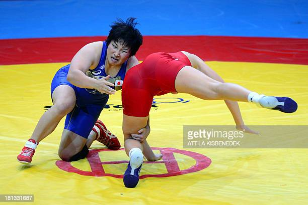Germany's Aline Focken and Japan's Sara Dosho fight during the women's free style 67 kg category for bronze of the FILA World Wrestling Championships...