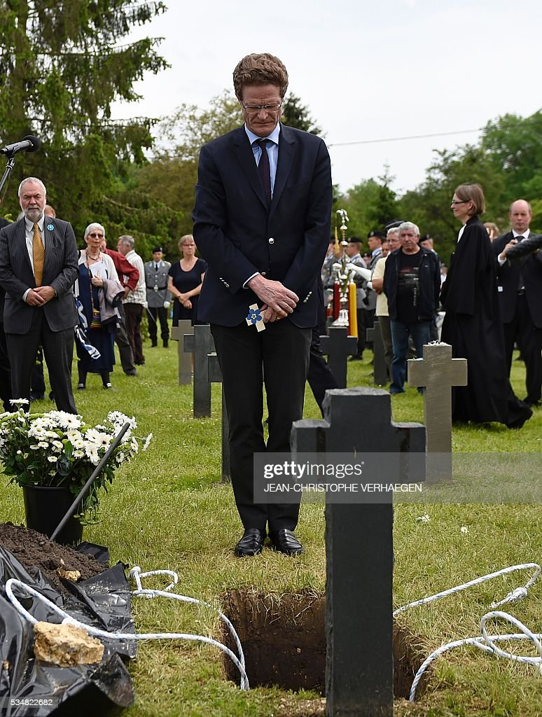 Germany's ambassador to France Nikolaus Meyer-Landrut pays his respects during the burial of Hans Winckelmann, a German soldier who died in WWI, at the German WWI cemetery of Romagne-sous-Montfaucon, eastern France, on May 28, 2016, as part of the 100-year commemoration of WWI's Battle of Verdun. VERHAEGEN