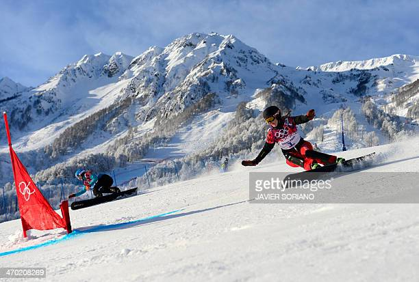 Germany's Amelie Kober and Switzerland's Patrizia Kummer compete in the Women's Snowboard Parallel Giant Slalom qualification run at the Rosa Khutor...