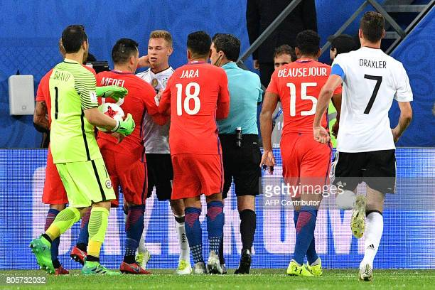 Germany's and Chile's players argue during the 2017 Confederations Cup final football match between Chile and Germany at the Saint Petersburg Stadium...