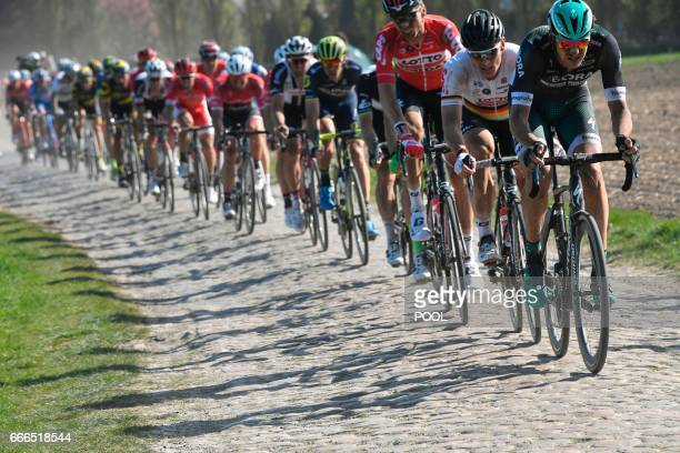 Germany's Andre Greipel rides on the cobblestones in the pack during the 115th edition of the ParisRoubaix oneday classic cycling race between...