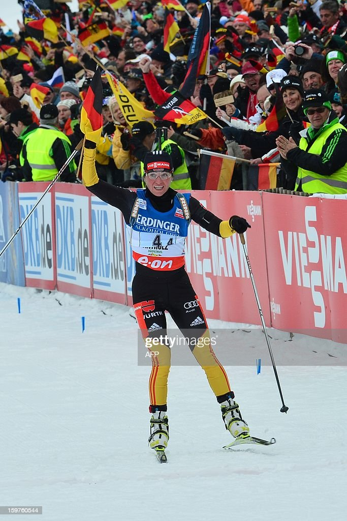 Germany's Andrea Henkel celebrates on the finish line her team's first place in the 4x6 kilometers' relay race of the women's biathlon World Cup race on January 20, 2013 in Antholz-Anterselva.Germany team won ahead of Russia and France Ukraine.