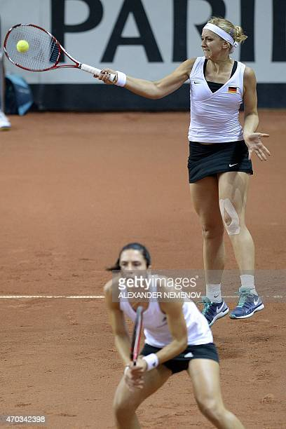 Germany's Andrea Petkovic and Sabine Lisicki return a serve to Russia's Anastasia Pavlyuchenkova and Elena Vesnina during their Federation Cup tennis...