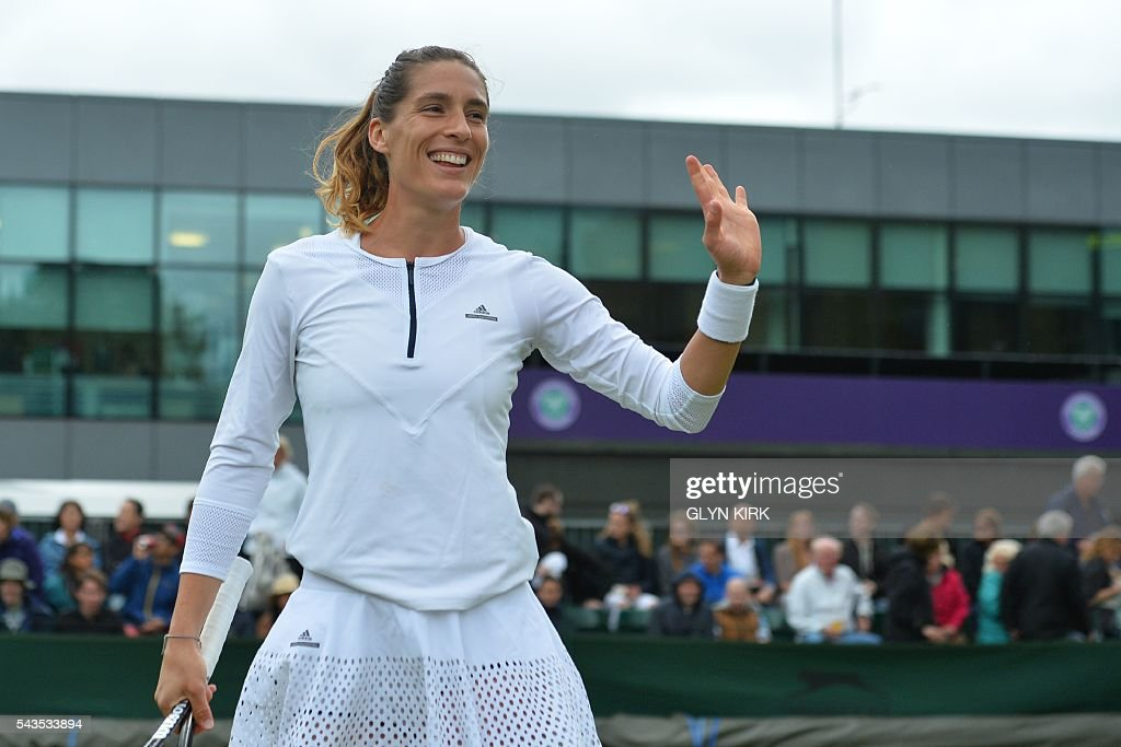 Germany's Andrea Petkovic celebrates beating Japan's Nao Hibino during their women's singles first round match on the third day of the 2016 Wimbledon Championships at The All England Lawn Tennis Club in Wimbledon, southwest London, on June 29, 2016. / AFP / GLYN