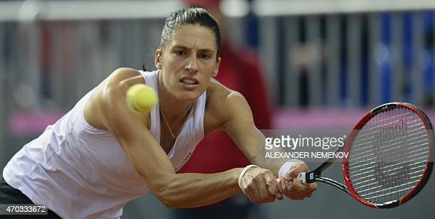 Germany's Andrea Petkovic returns a service to Russia's Svetlana Kuznetsova during their Federation Cup tennis world group semifinal match between...