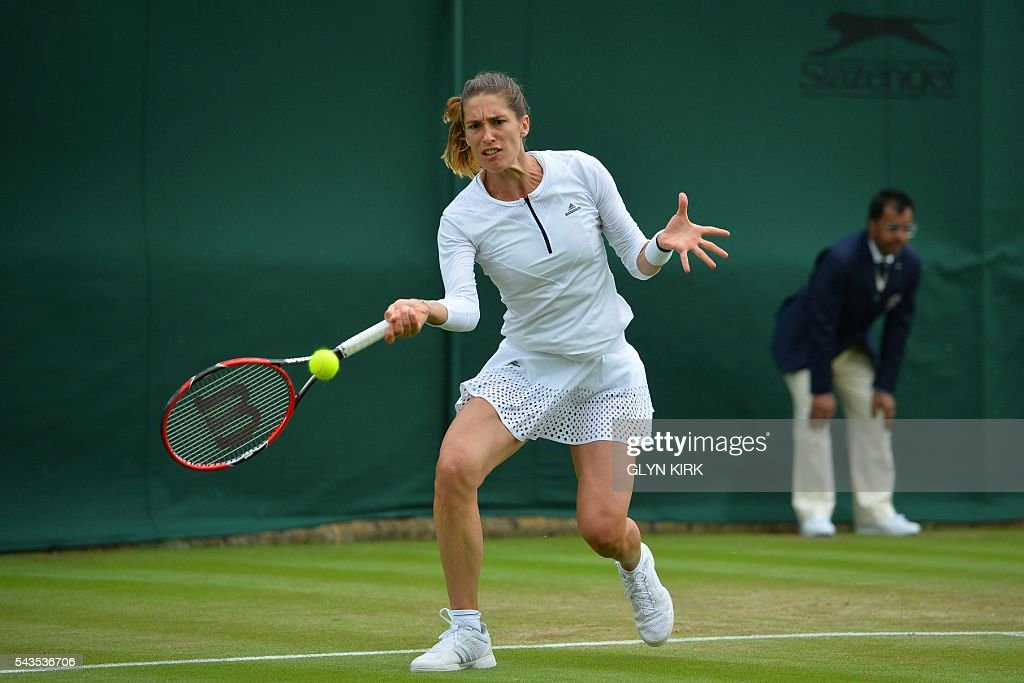 Germany's Andrea Petkovic returns against Japan's Nao Hibino during their women's singles first round match on the third day of the 2016 Wimbledon Championships at The All England Lawn Tennis Club in Wimbledon, southwest London, on June 29, 2016. / AFP / GLYN