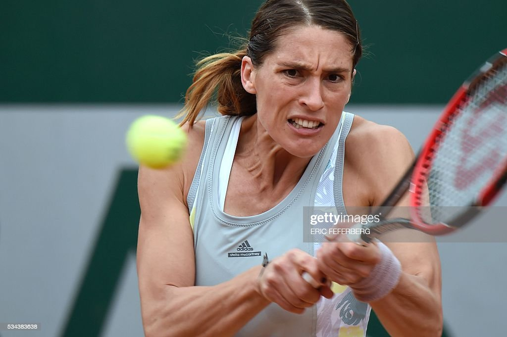 Germany's Andrea Petkovic returns the ball to Kazakhstan's Yulia Putintseva during their women's second round match at the Roland Garros 2016 French Tennis Open in Paris on May 26, 2016. / AFP / Eric FEFERBERG