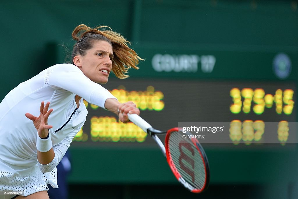 Germany's Andrea Petkovic serves against Japan's Nao Hibino during their women's singles first round match on the third day of the 2016 Wimbledon Championships at The All England Lawn Tennis Club in Wimbledon, southwest London, on June 29, 2016. / AFP / GLYN