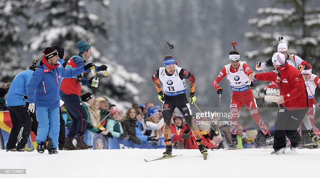 Germany's Andreas Birnbacher and Norway's Ole Einar Bjoerndalen compete in the men's 15 kilometers mass start competition at the Biathlon World Cup...