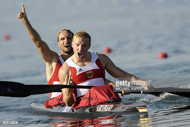 Germany's Andreas Ihle and Martin Hollstein celebrate after winning the mens Kayak double 1000m of the 2008 Beijing Olympic Games at the Shunyi...