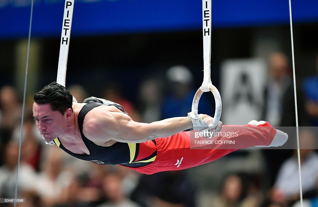 Germany's Andreas Toba performs during the Mens rings competition of the European Artistic Gymnastics Championships 2016 in Bern, Switzerland on May 28, 2016. / AFP / FABRICE