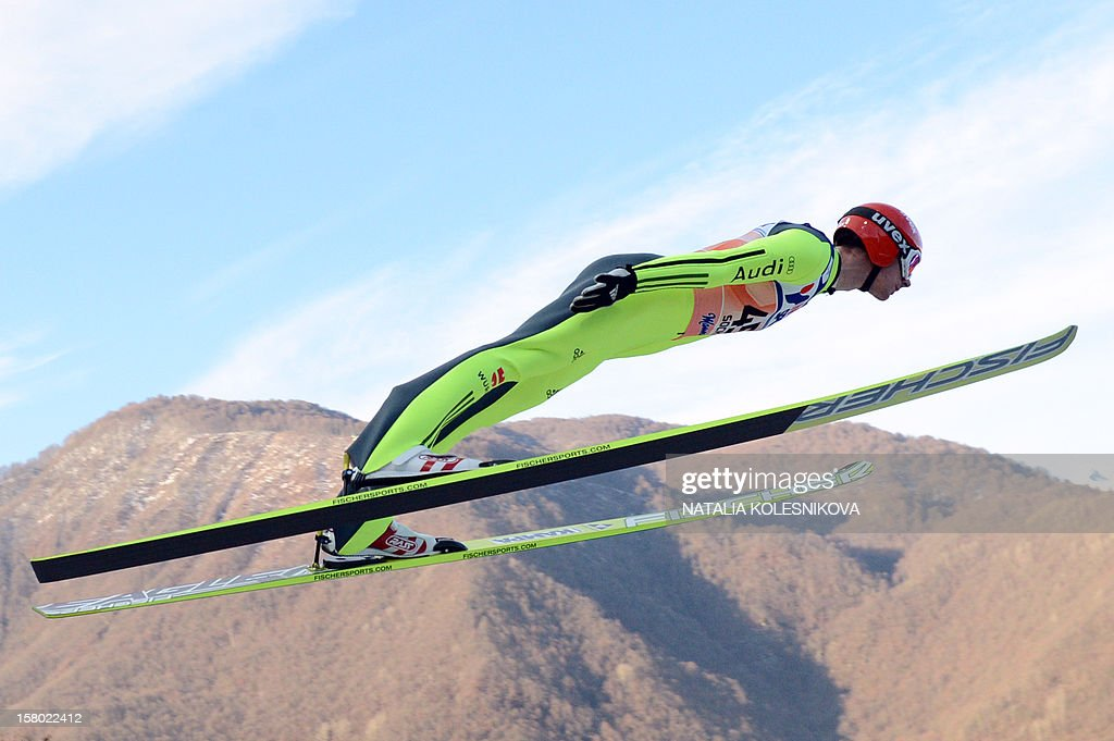 Germany's Andreas Wank jumps during the men's normal hill individual at the FIS Ski Jumping World Cup tournament in Sochi on December 9, 2012.
