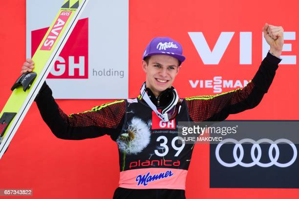 Germany's Andreas Wellinger celebrates after placing second in the FIS Ski Jumping World Cup Flying Hill Individial Competition on March 24 2017 in...