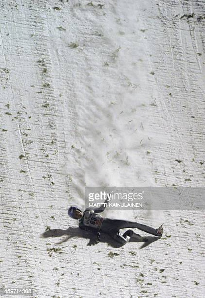 Germany's Andreas Wellinger slides down the slope as he falls during the FIS Ski Jumping HS 142 World Cup in Ruka Kuusamo Finland on November 29 2014...