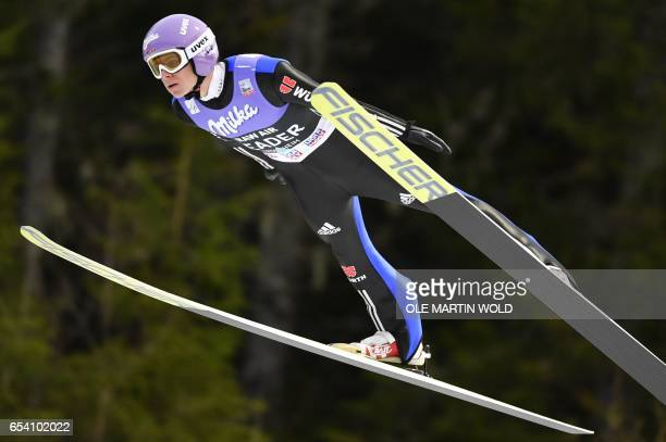 Germany's Andreas Wellinger soars through the air during FIS Ski Jumping World Cup Men's HS138 in Trondheim on March 16 2017 / AFP PHOTO / NTB...