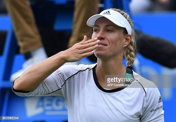 Germany's Angelique Kerber acknowledges the crowd after beating Czech Kristina Pliskova during their women's singles round two tennis match at the...
