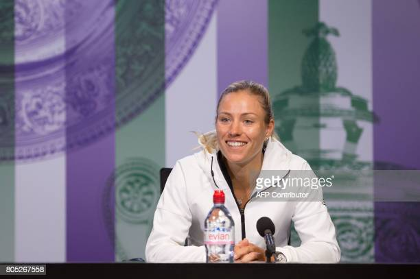 Germany's Angelique Kerber addresses a press conference in the Main Interview Room at Wimbledon on July 1 ahead of the Championship 2017 starting on...
