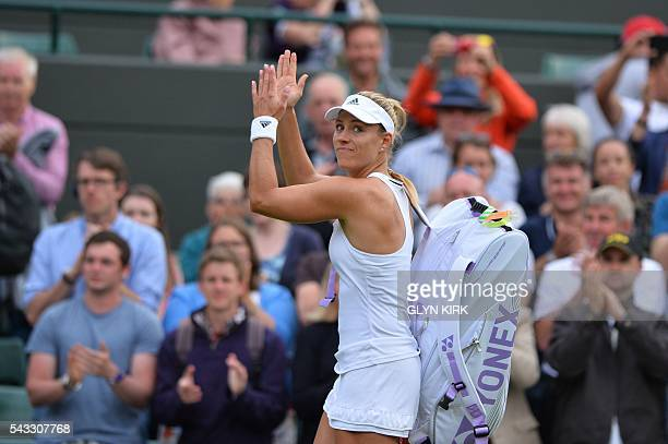 Germany's Angelique Kerber applauds the crowd as she leaves the court after beating Britain's Laura Robson during their women's singles first round...