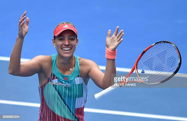 TOPSHOT Germany's Angelique Kerber celebrates after victory inher women's singles match against Belarus's Victoria Azarenka on day ten of the 2016...