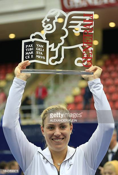 Germany's Angelique Kerber celebrates with her trophy after winning against Serbia's Ana Ivanovic during their final match of the WTA tennis...