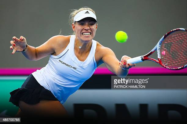 Germany's Angelique Kerber hits a return against Australia's Sam Stosur during their match in the Fed Cup semifinal tie tennis match between...