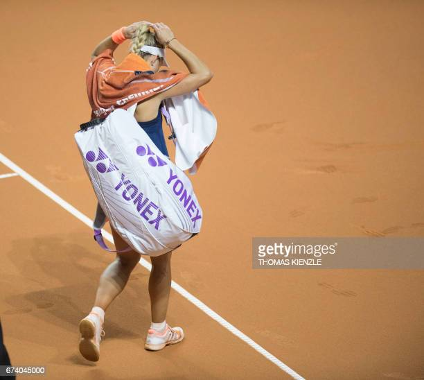 Germany's Angelique Kerber leaves the court after she lost against France's Kristina Mladenovic in their second round match at the WTA Porsche Tennis...