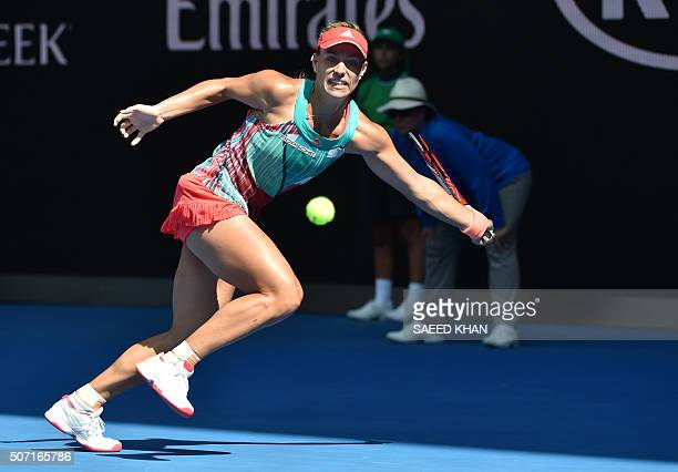 Germany's Angelique Kerber plays a forehand return during her women's singles semifinal match against Britain's Johanna Konta on day eleven of the...