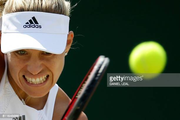 TOPSHOT Germany's Angelique Kerber returns against Spain's Garbine Muguruza during their women's singles fourth round match on the seventh day of the...
