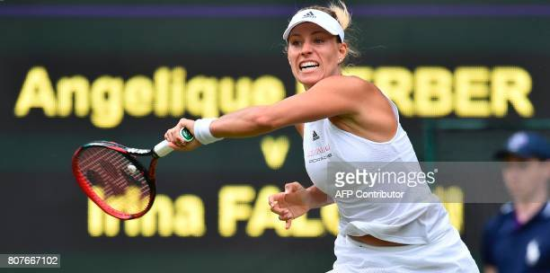 Germany's Angelique Kerber returns against US player Irina Falconi during their women's singles first round match on the first day of the 2017...