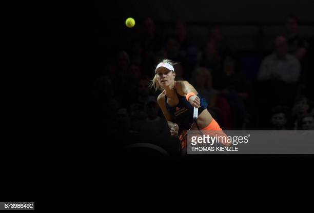 Germany's Angelique Kerber returns the ball to France's Kristina Mladenovic in their second round match at the WTA Porsche Tennis Grand Prix in...