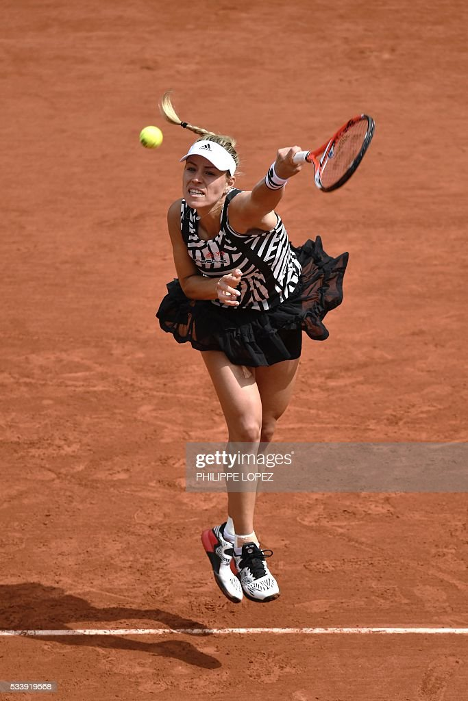 Germany's Angelique Kerber serves the ball to the Netherlands' Kiki Bertens during their women's first round match at the Roland Garros 2016 French Tennis Open in Paris on May 24, 2016. / AFP / PHILIPPE