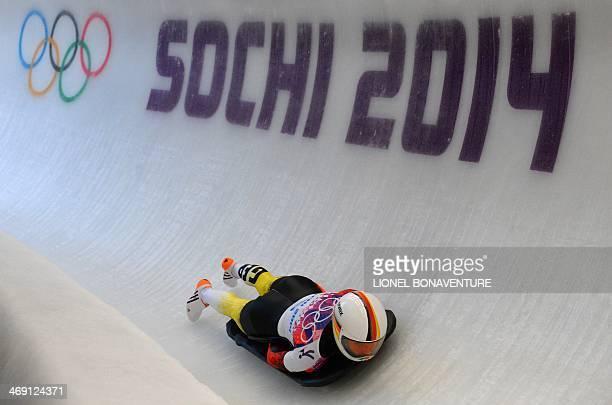 Germany's Anja Huber Heat 2 of the Women's Skeleton event of the Sochi Winter Olympics on February 13 2014 at the Sanki Sliding Center in Rosa Khutor...