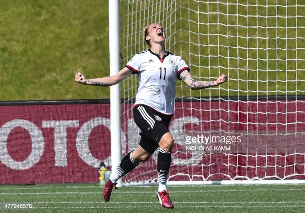 Germany's Anja Mittag celebrates scoring against Sweden during a 2015 FIFA Women's World Cup round of 16 match at Lansdowne Stadium in Ottawa on June...