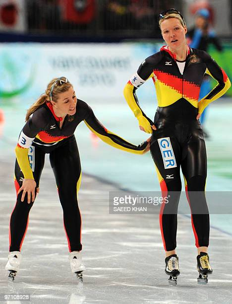 Germany's Anna FriesingerPostma and Germany's Stephanie Beckert react after competing in the Ladies' team pursuit speedskating quaterfinals at the...