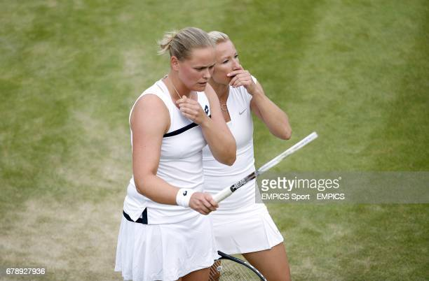 Germany's AnnaLena Groenefeld and Czech Republic's Kveta Peschke react in their women's doubles match against Great Britain's Laura Robson and USA's...
