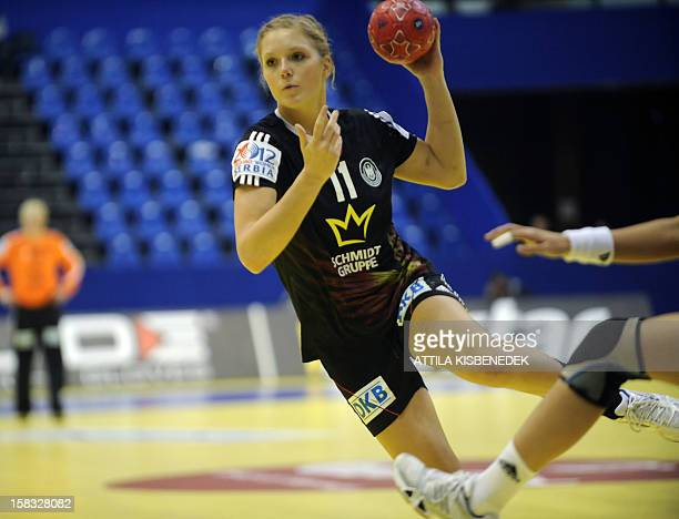 Germany's Anne Hubinger passes the ball against Romania during the 2012 EHF European Women's Handball Championship Group II match of main round on...