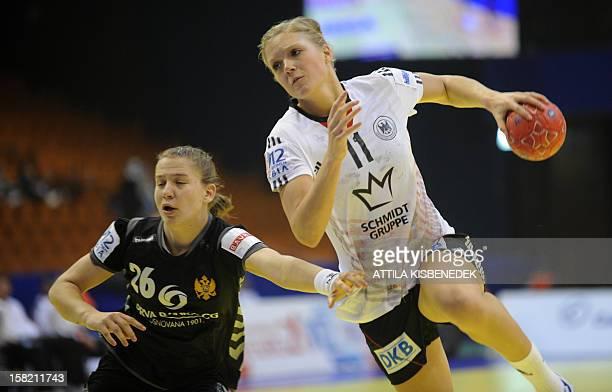Germany's Anne Hubinger scores a goal against Montenegro's pivot Suzana Lazovic during the 2012 EHF European Women's Handball Championship Group II...