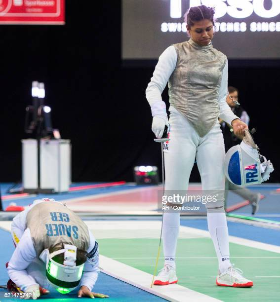 Germany's Anne Sauer celebrates after winning her qualification match against Ysaora Thibus of France during the Women's Team Foil competition at the...