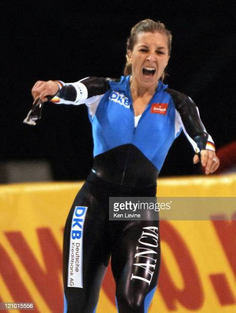 Germanys Anni Friesinger celebrates a new short lived world record at the Essent ISU World Cup Women's 1500 m speed skating event at the Utah Olympic...