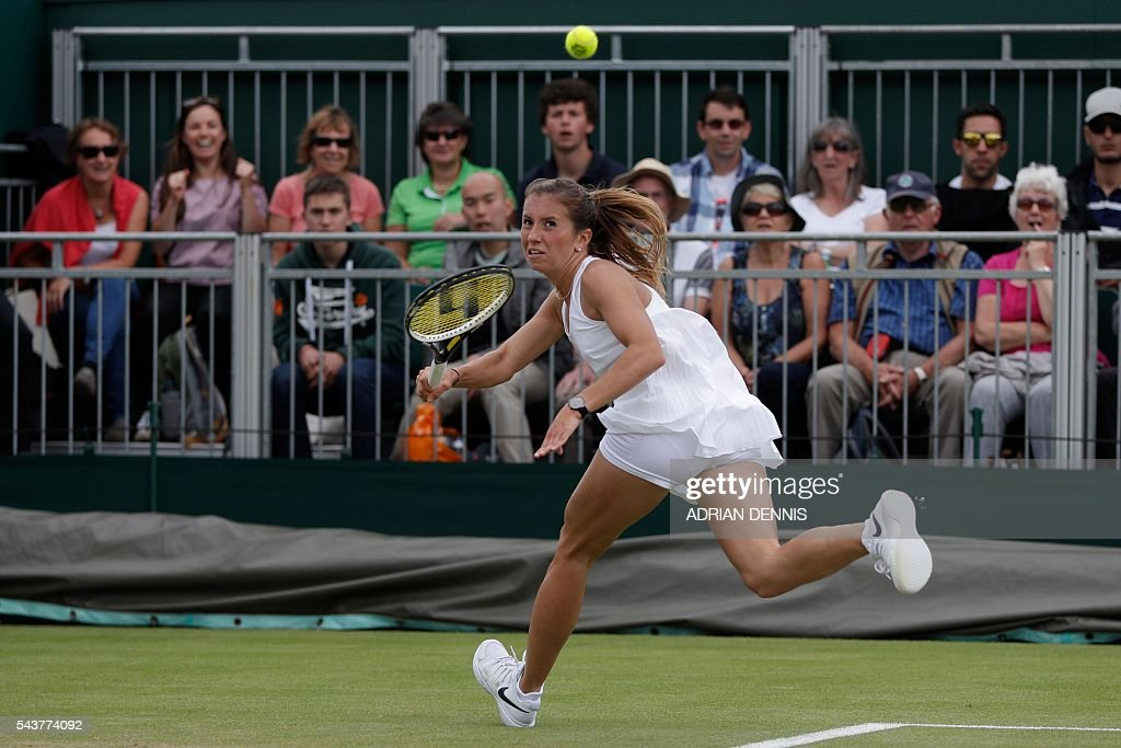 Germany's Annika Beck returns against Britain's Heather Watson during their women's singles first round match on the fourth day of the 2016 Wimbledon Championships at The All England Lawn Tennis Club in Wimbledon, southwest London, on June 30, 2016. / AFP / ADRIAN